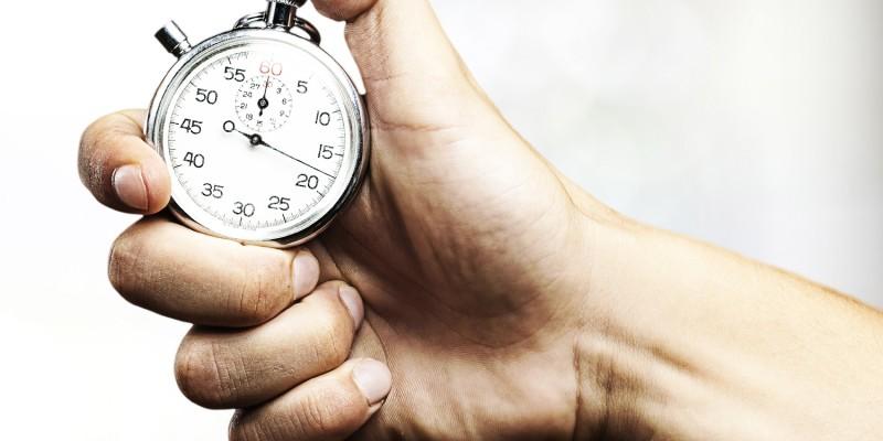 hand holding stopwatch