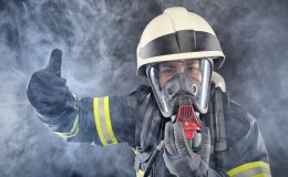 Firewoman in fire protection suit